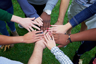 Photo of Diverse Group of Student Hands