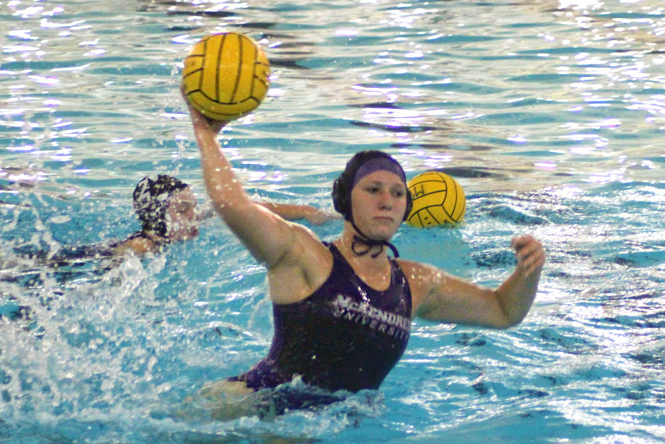 McKendree Women's water polo athlete throwing ball