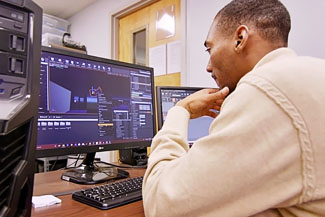 Photo of Jacob Troutman '18 Working at Computer