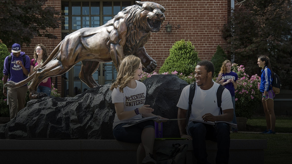 Photo of Students Gathered Around Bearcat Statue