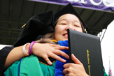 Graduate in Cap and Gown at Commencement