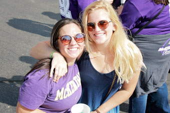 Two Female Alumni at Homecoming Tailgate Area