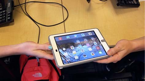 Students Passing an iPad
