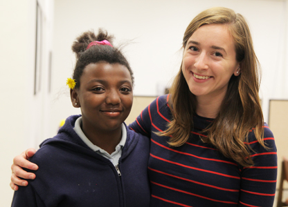 Photo of Acadia Reynolds with a Student