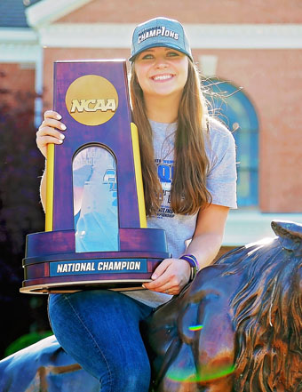 Photo of Jessica Mellott '18 holding NCAA Champion Trophy