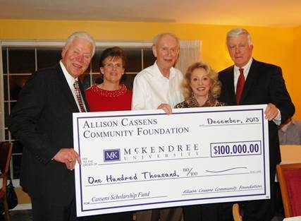 Photo of President Dennis Receiving the Allison Cassens Scholarship Check