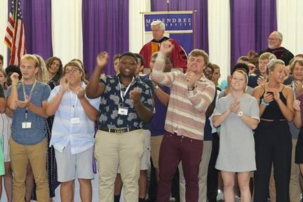 New students sing the university fight song during the Convocation on Aug. 21.