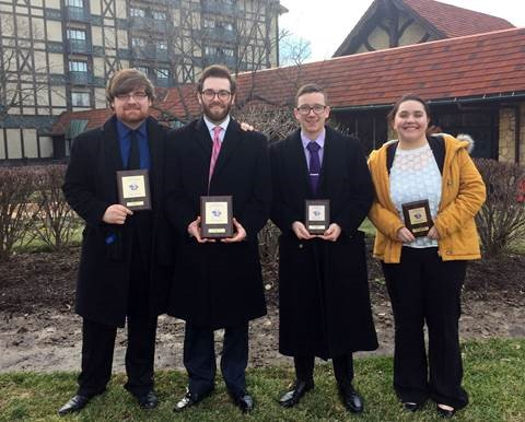 Kyle Garrett, Kyle Smith, Caden Owens and Rebecca Postula at Webster University's Gorlok Gala speech tournament.