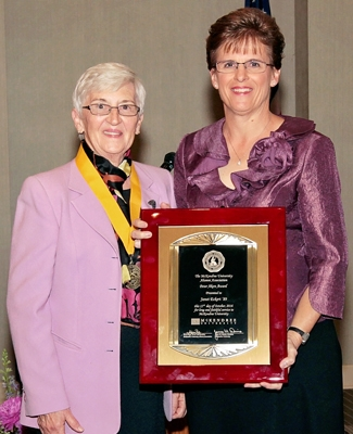 Photo of Janet Eckert Receiving Award from Victoria Dowling