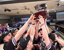 Photo of Men's Bowling Team Lifting National Trophy