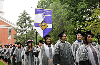 Students at Commencement in Rain