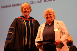 Dr. Christine Bahr congratulates Martha McDonald