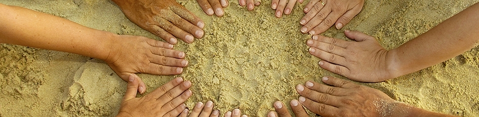 Photo of Hands in the Sand