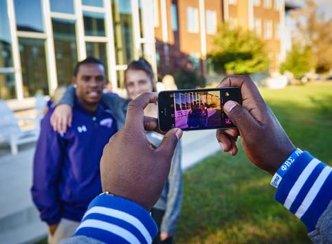 Students Taking a Photo on Campus
