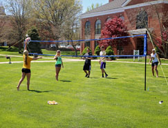 Photo of Students Playing Volleyball on Campus Quad