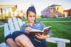 Photo of Student Reading Outside