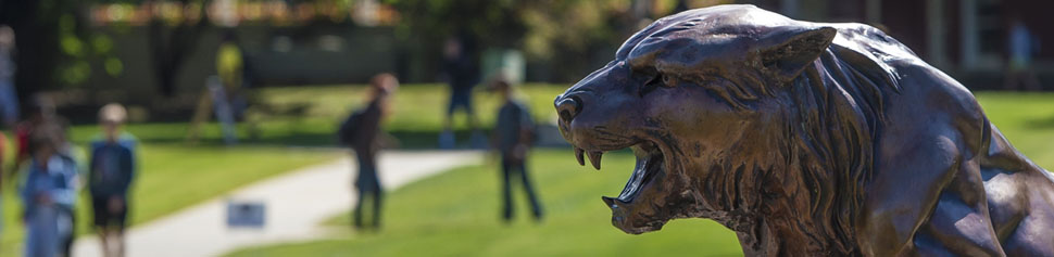 Bearcat Statue in the Campus Quad with Students in Background