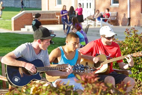 Students PLaying the Guitar